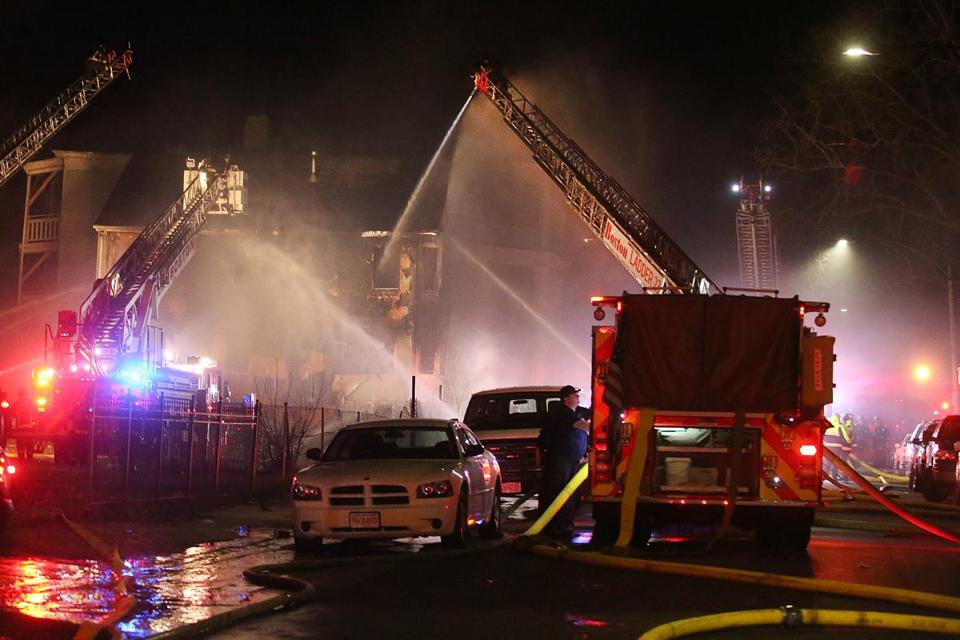 Firefighters worked Wednesday night to extinguish the three-alarm fire at 27 Hansborough St.