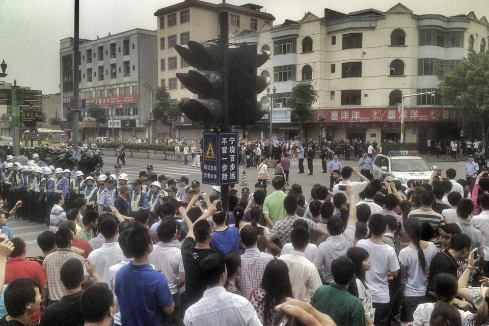 Workers protested during a strike as police stood guard at Yue Yuen  Industrial.