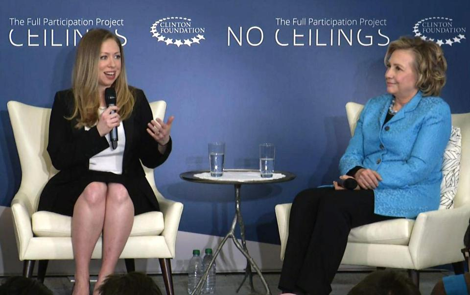 "In this image taken from video, Chelsea Clinton, left, speaks to the audience as she co-hosts ""Girls: A No Ceilings Conversation,"" with her mother, former Secretary of State Hillary Rodham Clinton, in New York, Thursday, April 17, 2014. The daughter of former president Bill Clinton and the former Secretary of State announced at the event that she is pregnant with her first child at the Clinton Foundation event. (AP Photo/Ted Shaffrey)"