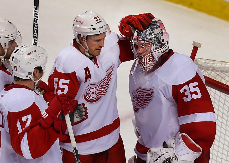 Congratulations were in order after Red Wings goalie Jimmy Howard saved all 25 shots he faced.