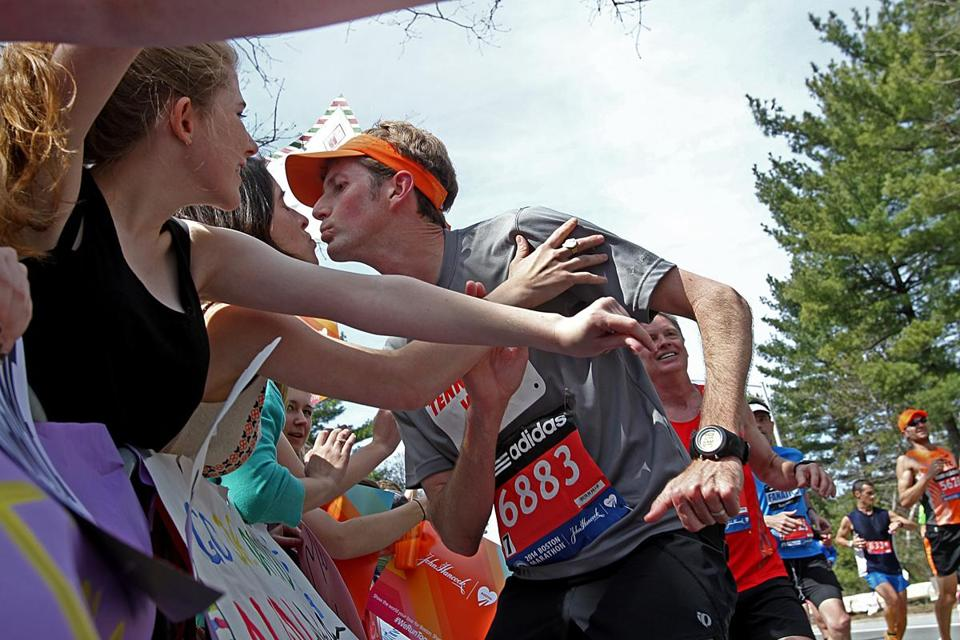 A runner came in for a kiss from a Wellesley College student in the scream tunnel.