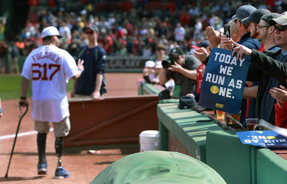 Bombing survivor Marc Fucarile acknowledged cheers from onlookers after throwing out the ceremonial first pitch before Monday's Red Sox game.