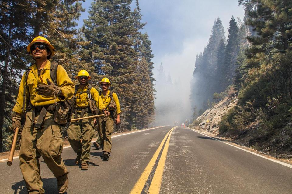 Offsetting the forest firefighters in Yosemite adds punch and makes it more evocative.