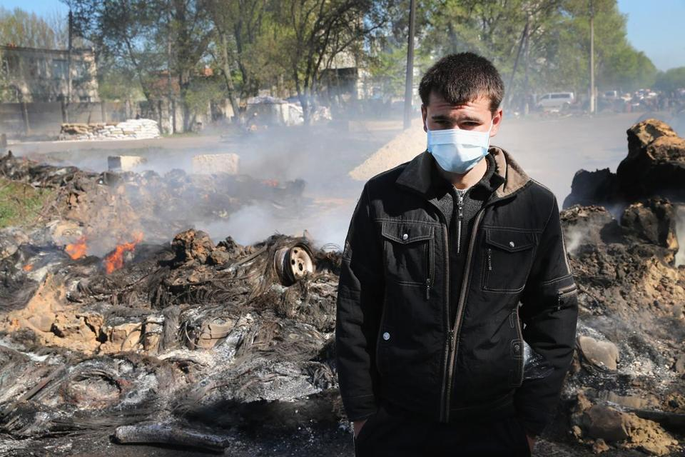 A pro-Russian activist stood guard at a roadblock after an attack by a Ukrainian army unit near Slovyansk, Ukraine.