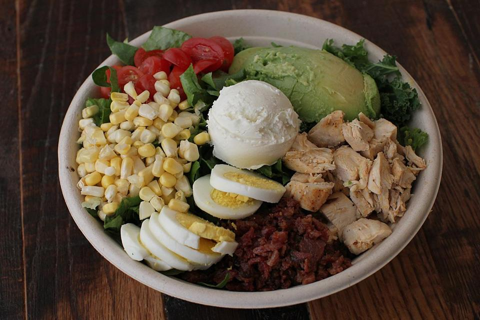 Boston, MA., 04/25/14, For Cheap Eats: Sweetgreen is a salad bar restaurant right at the finish line of the Boston Marathon.This is the District Cobb salad. Suzanne Kreiter/Globe staff (The Boston Globe.