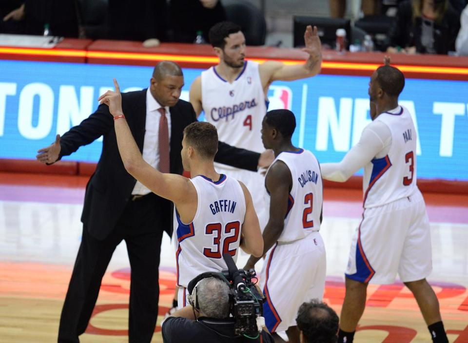 Doc Rivers celebrated with Clippers players after finishing off a win against the Warriors.