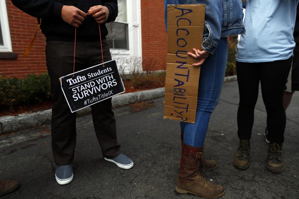 Students last week held signs as they protested the handling of sexual assault complaints at Tufts University.