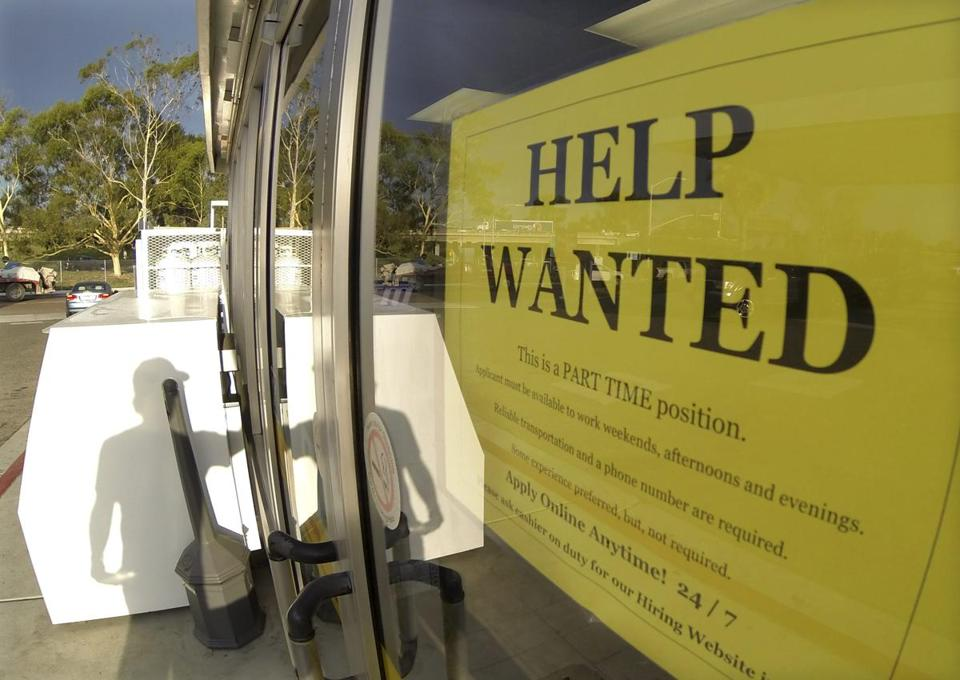 A help wanted sign on the door of a gas station in Encinitas, Calif.