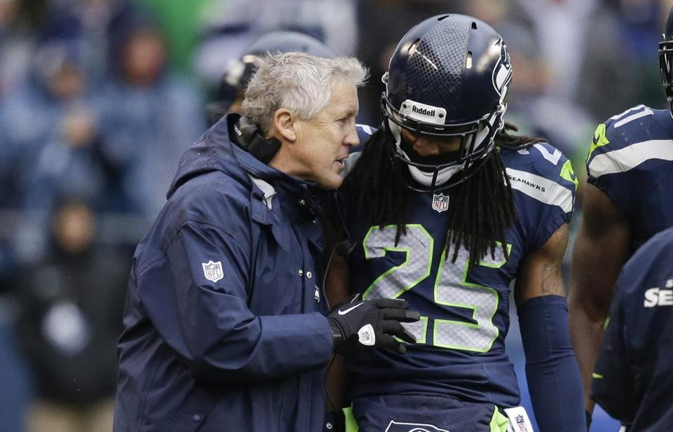 Seahawks head coach Pete Carroll, left, struck gold when he drafted cornerback Richard Sherman in the fifth round in 2011.