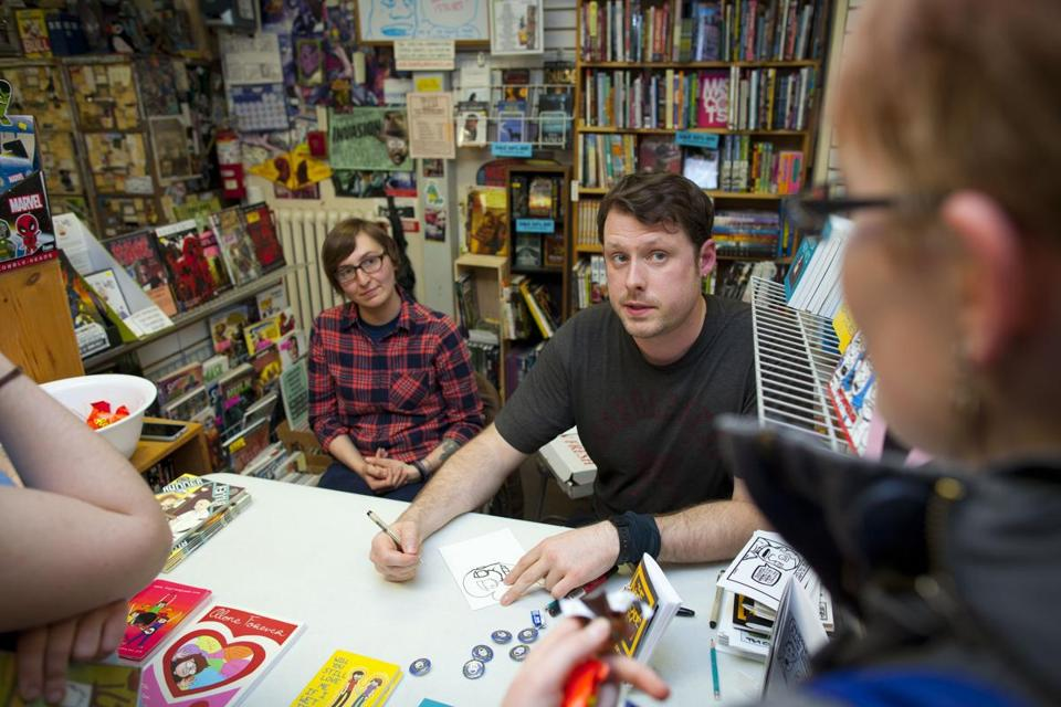Tim Chamberlain and Liz Prince (left) at a signing at New England Comics in Cambridge on Saturday.