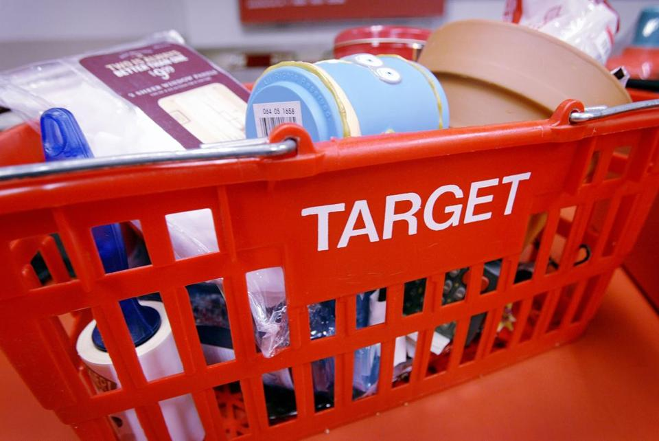 Target Corp's fourth-quarter profit fell 46 percent on a revenue decline of 5.3 percent as some customers remained wary after the retailer revealed a massive data breach.
