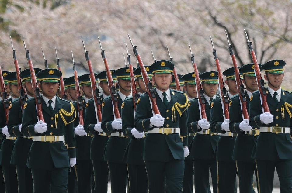 Members of a Japanese Self-Defense Forces honor guard march in Tokyo. Japan marked the 67th anniversary of its postwar constitution with growing debate over whether to revise the war-renouncing document. Prime Minister Shinzo Abe's ruling conservative party has long advocated revision but been unable to sway public opinion.