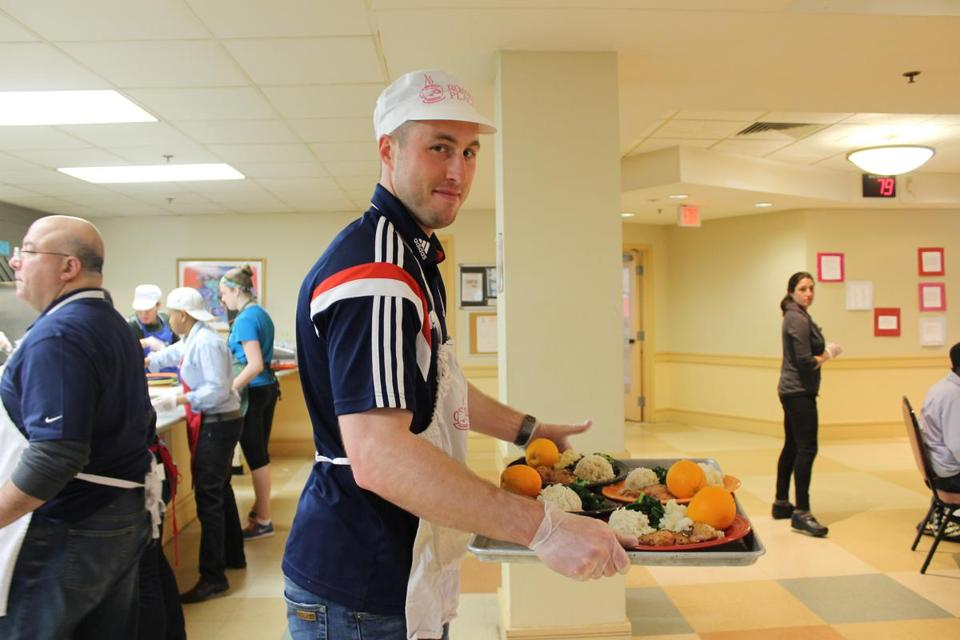 Brad Knighton served dinner at Rosie's Place on Wednesday night.