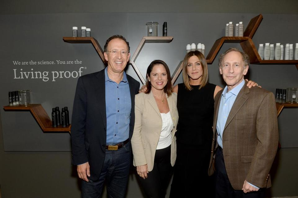 Jennifer Aniston (second from right) with Living Proof CEO Jill Beraud and cofounders Jon Flint (left) and Robert Langer in Cambridge.