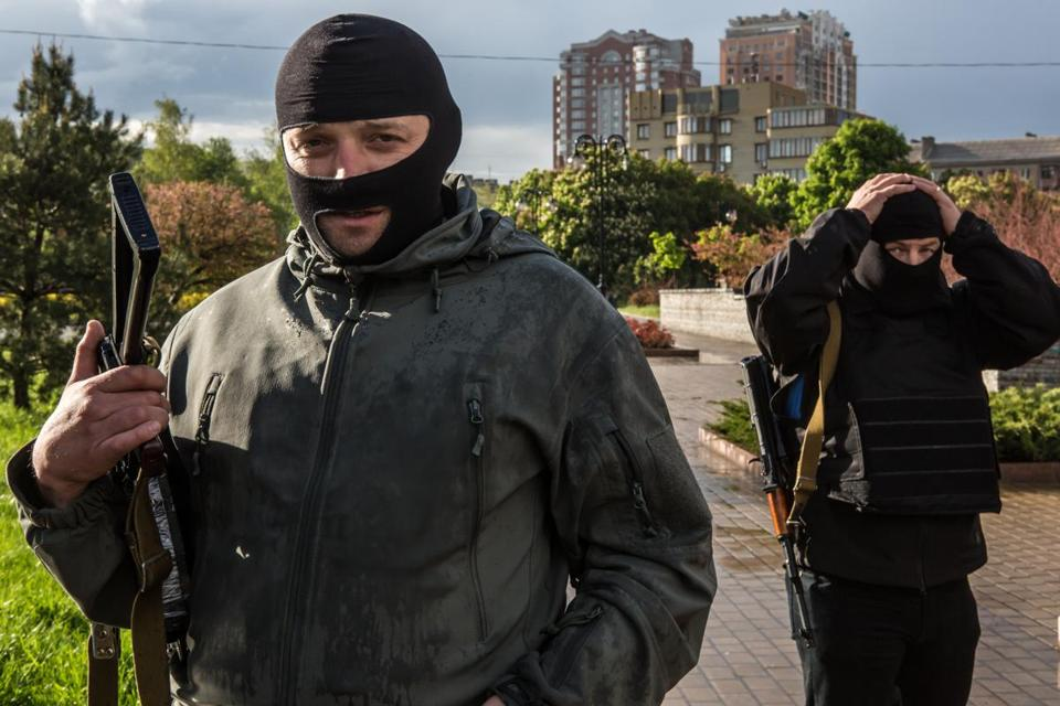 Pro-Russian activists posed for a picture Thursday outside the occupied regional administration building in Donetsk, Ukraine.