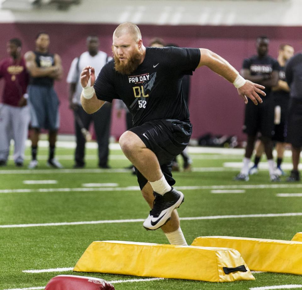 Center Bryan Stork runs a drill during the Pro Day at Florida State University in March. (AP Photo/Colin Hackley)