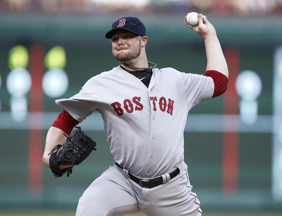 Red Sox starter Jon Lester went seven innings, allowing three runs, to even his record at 4-4. (Jim Cowsert/Associated Press)