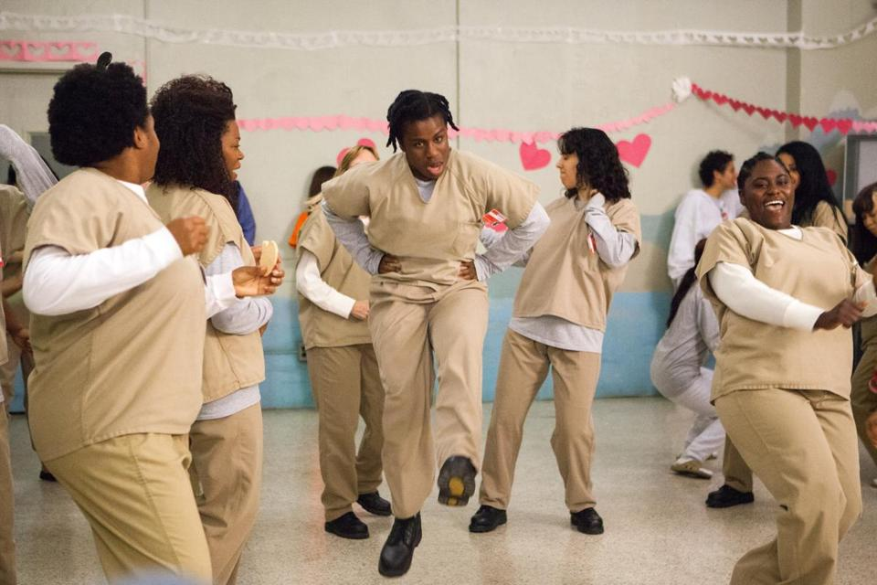 "Uzo Aduba (center) as Suzanne, also known as Crazy Eyes, on ""Orange Is the New Black."""