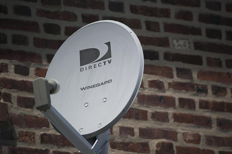 A DirecTV Dish Is Seen Outside A Home In The Queens Borough Of New York In