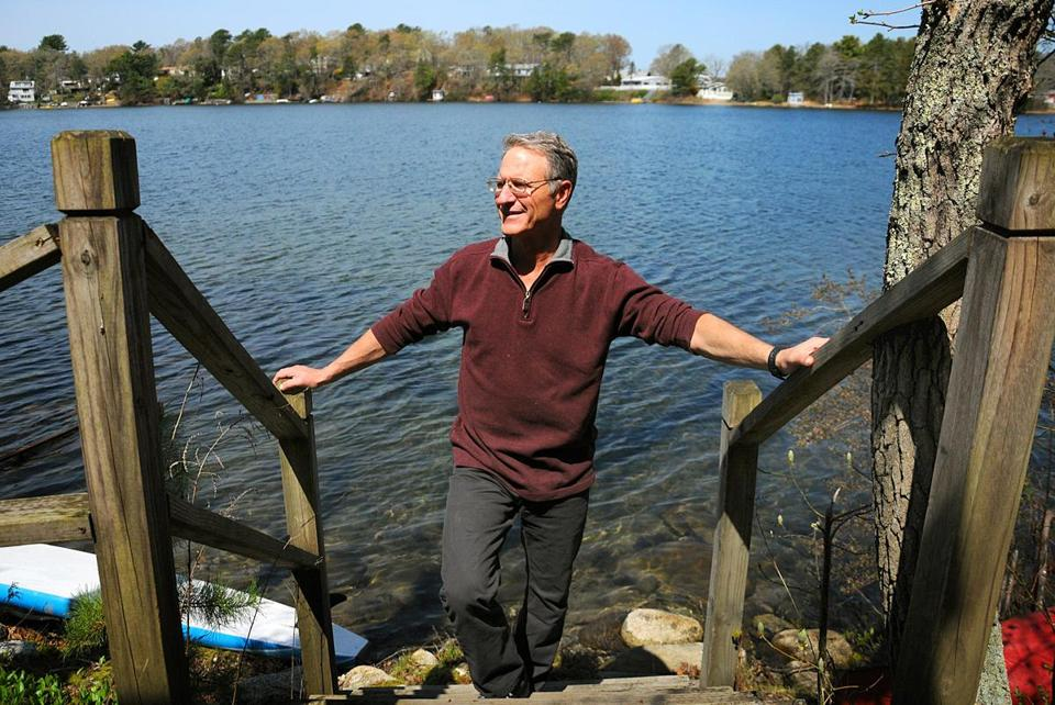 Author Michael Tougias at his home on Ezekiel's Pond in Plymouth.