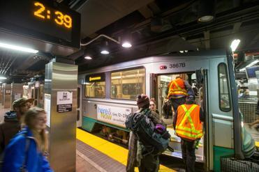 Riders boarded a late Green Line train on March 29.