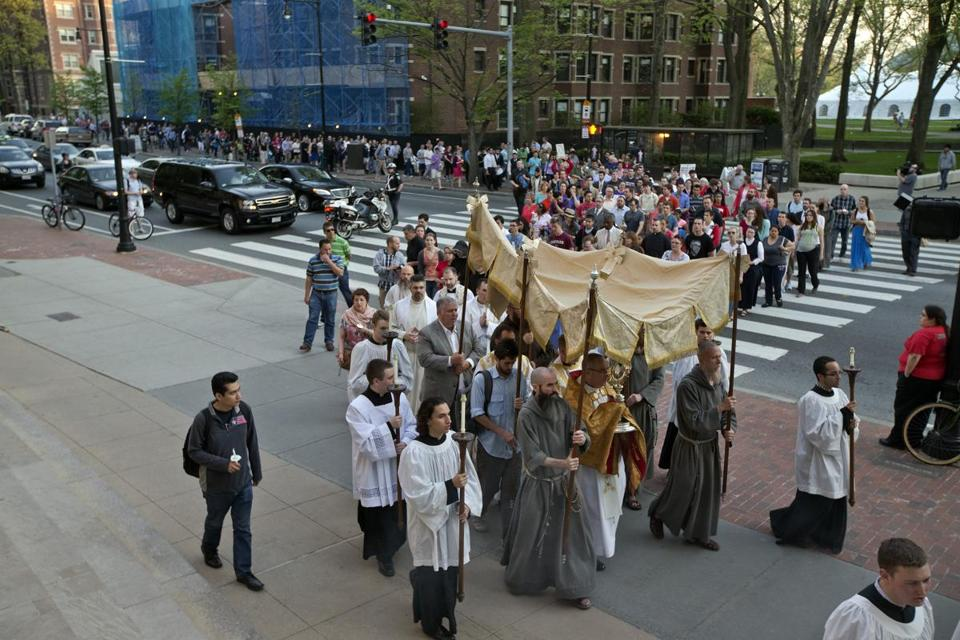 Hundreds marched from the chapel at Massachusetts Institute of Technology to St. Paul Church in Harvard Square last week in response to a planned black mass.