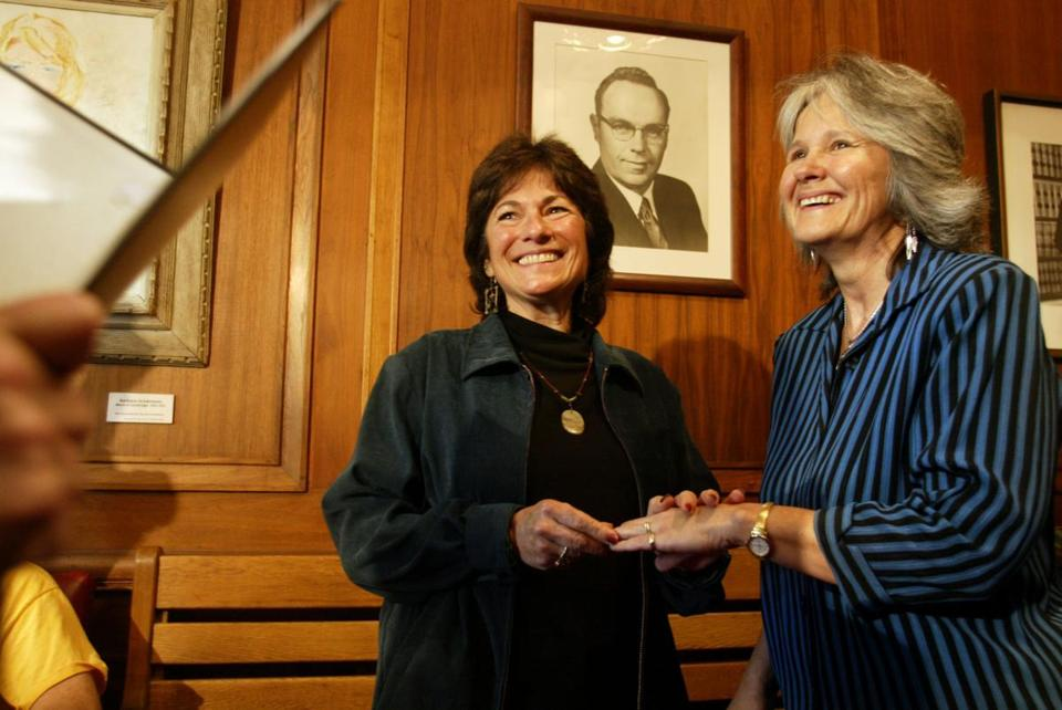 Marcia Kadish (left) and Tanya McCloskey are exchange rings as they are married before Clerk D. Margaret Drury at Cambridge City Hall May 17, 2004.