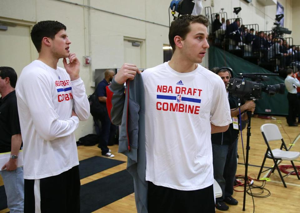 "Michigan's Nik Stauskas (right, with Doug McDermott of Creighton) was one of the combine players who sat down with the Celtics to be ""grilled."" AP Photo/Charles Rex Arbogast"