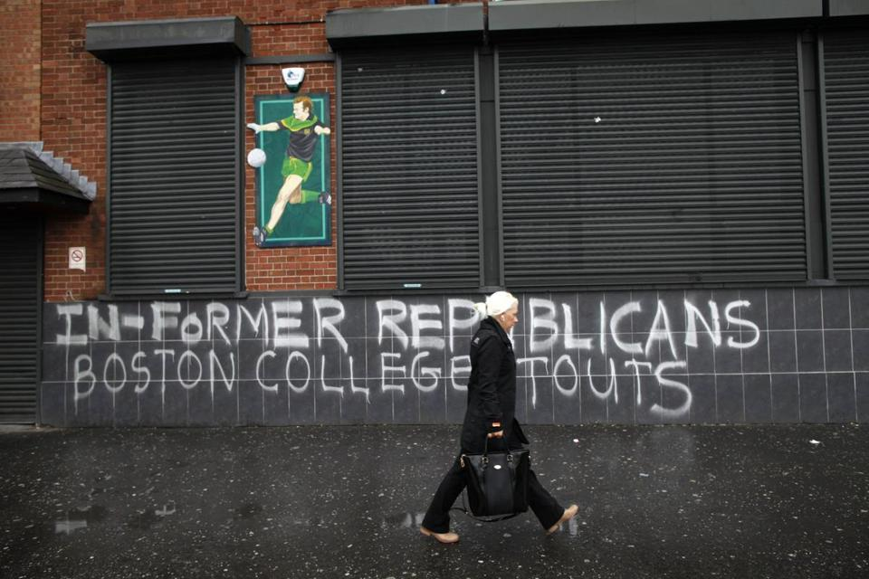 Graffiti along Falls Road in West Belfast, Northern Ireland, refers to former IRA members who took part in Boston College's IRA oral history.