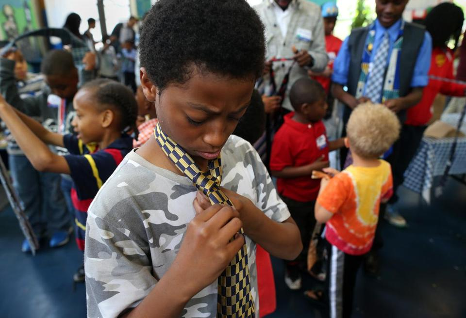 Maxwell Blake, 11, practiced tying a Windsor knot, one of the skills taught Saturday at the Black Man Can Institute's mentoring workshop, held at the Shady Hill School in Cambridge.