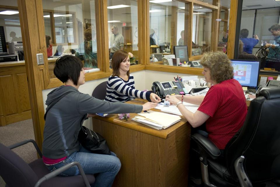 Beth Moore (left) and Abby Hill (center) applied for a marriage license in Fayetteville, Ark.