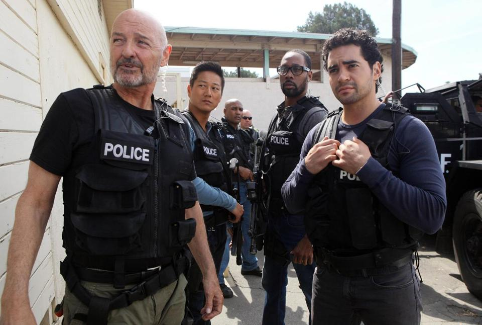"Ramon Rodriguez stars as detective Ryan Lopez (right, with Terry O'Quinn as his task force boss) in ""Gang Related."""
