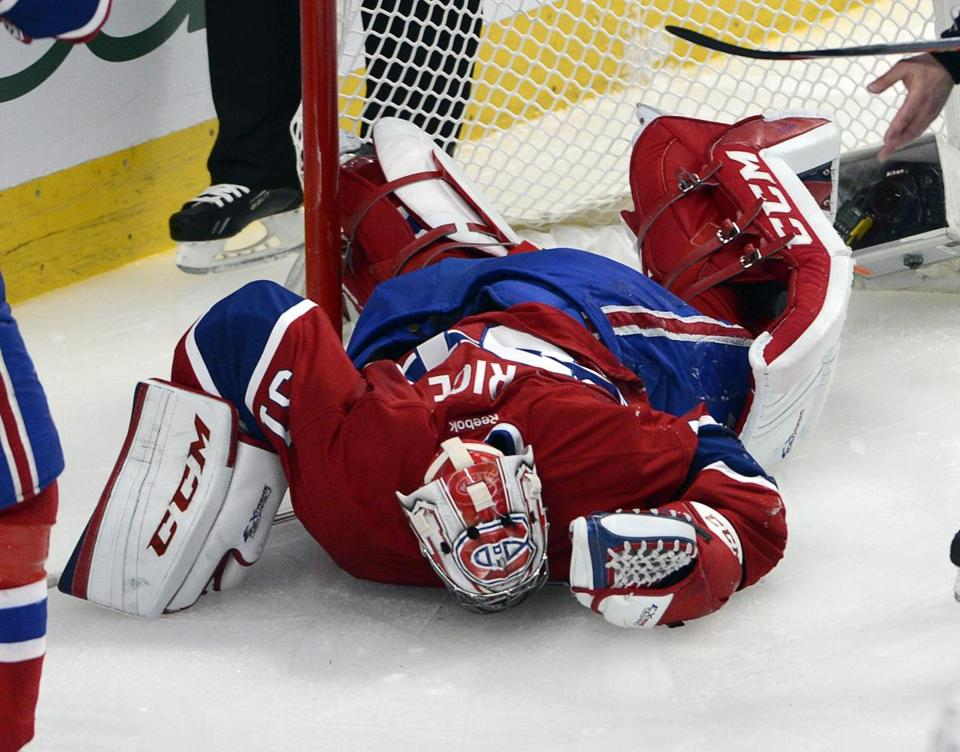 Canadiens goalie Carey Price is down — apparently with a right knee injury — after being run into by New York's Chris Kreider Saturday. AP Photo/The Canadian Press, Ryan Remiorz