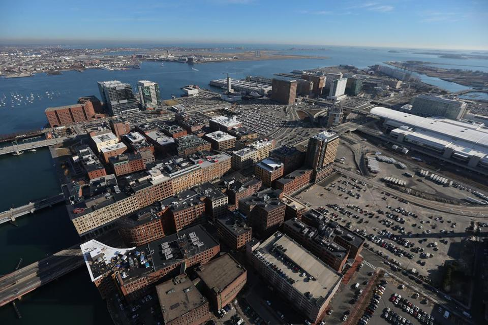 Developers have moved electrical units from the basements to rooftops of buildings in the Seaport District along Boston Harbor.