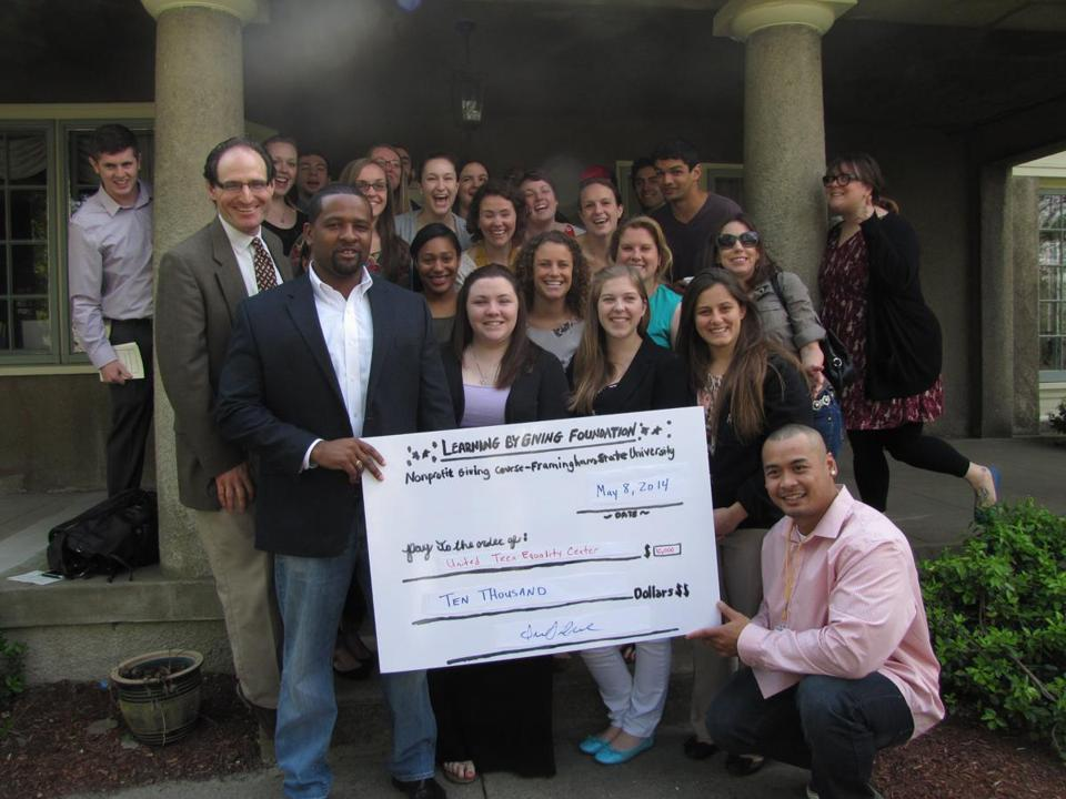 Students in Framingham State University sociology professor Ira Silver's Nonprofit Giving Course recently awarded $10,000 to Keon Webbe and Johnny Chheng of the United Teen Equality Center in Lowell.