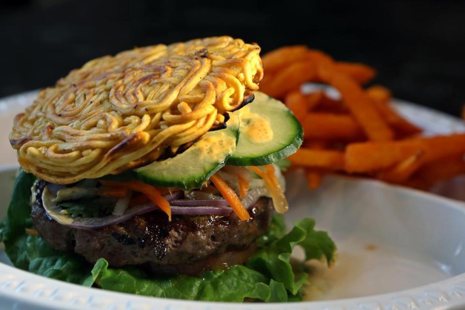 Banh mi burger on a ramen bun at this Asian-fusion spot ...