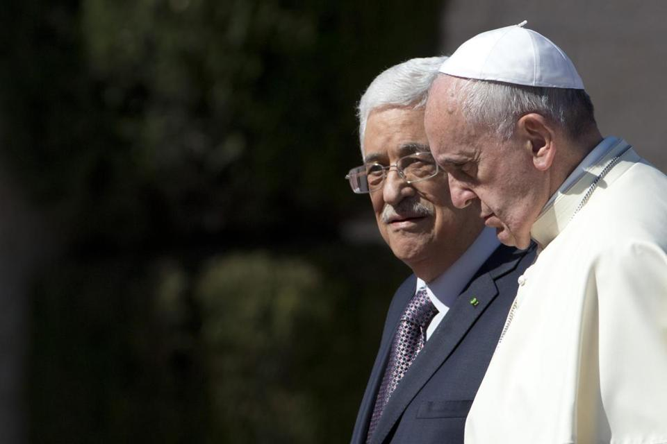 Pope Francis (right) and Palestinian president Mahmoud Abbas met Sunday in Bethlehem.