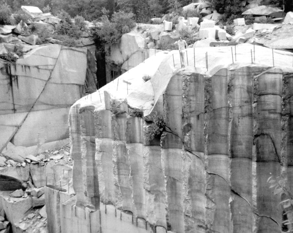 Images from the 1920s depict Milford's bustling quarry industry, which sent prized granite across the country; in the early 1970s, Fletcher's Quarry was drained for one last project.