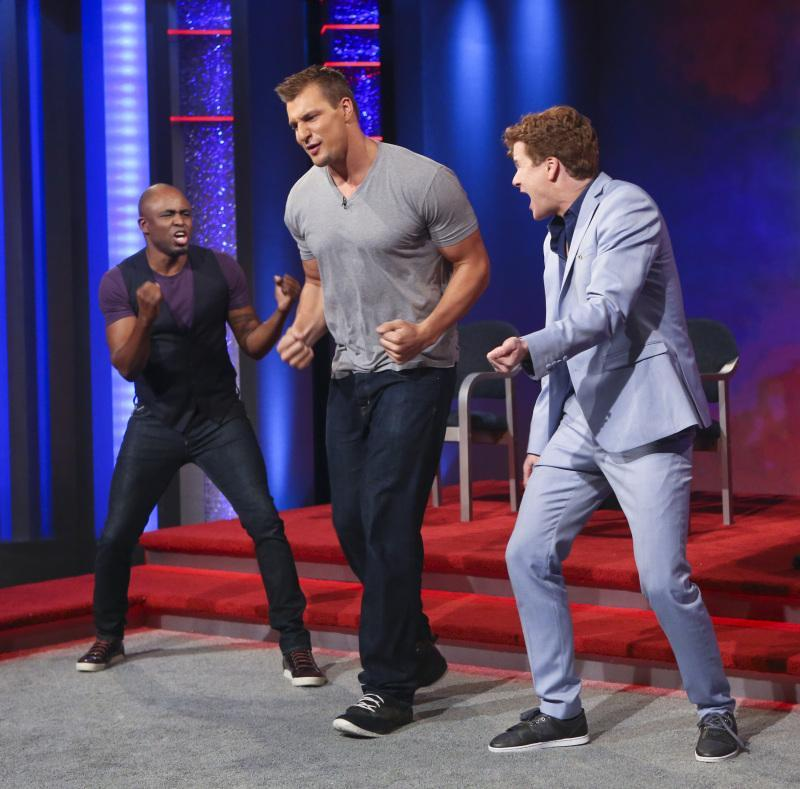 "Rob Gronkowski, center, dances with Wayne Brady, left, and Jonathan Mangum on ""Whose Line Is It Anyway?"""