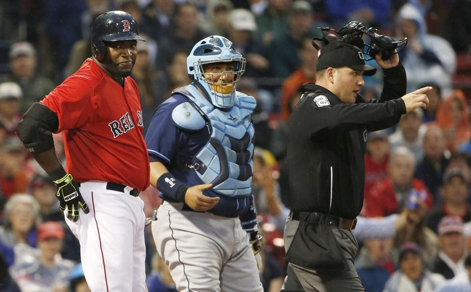 Umpire Dan Bellino warns David Price of the Rays after he hit the Red Sox' David Ortiz Friday night. Winslow Townson/Getty Images
