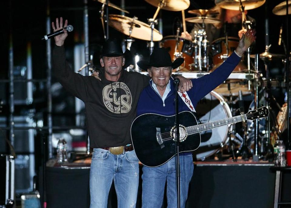 George Strait (right) with Tim McGraw before a crowd of more than 55,000 fans at Gillette Stadium Saturday.