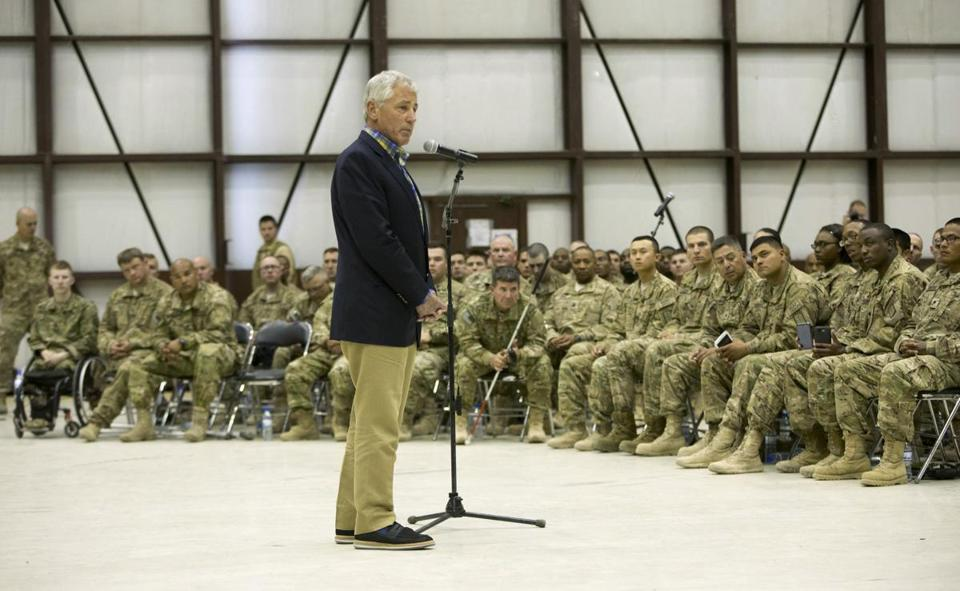 Defense Secretary Chuck Hagel met troops in Afghanistan. He said security steps were in place for the Taliban deal.