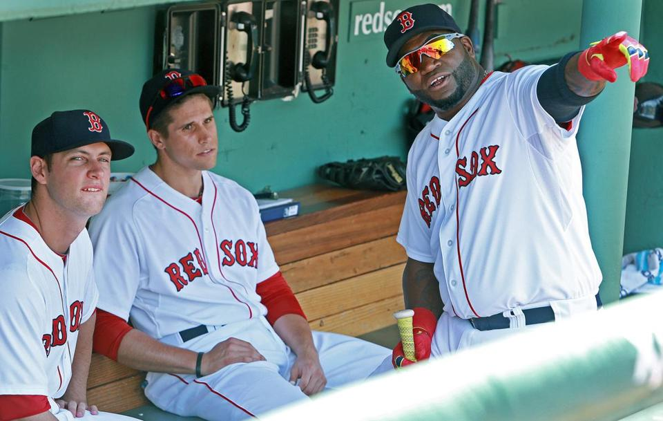 Alex Hassan, left, and fellow rookie Garin Cecchini listened closely as David Ortiz held court before the game.