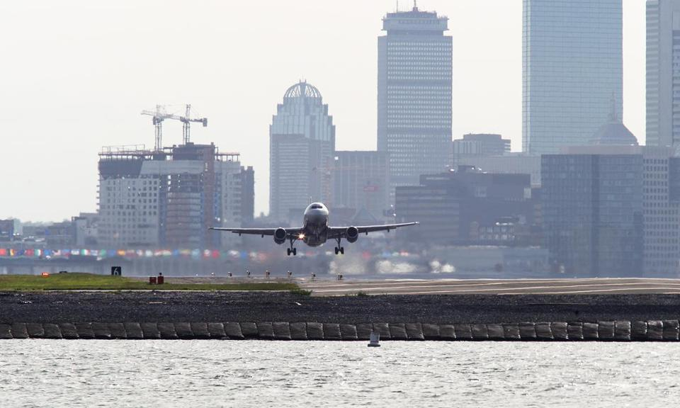 Logan Airport officials plan to curb energy consumption, cut emissions, and spend millions to protect runways from rising seas.