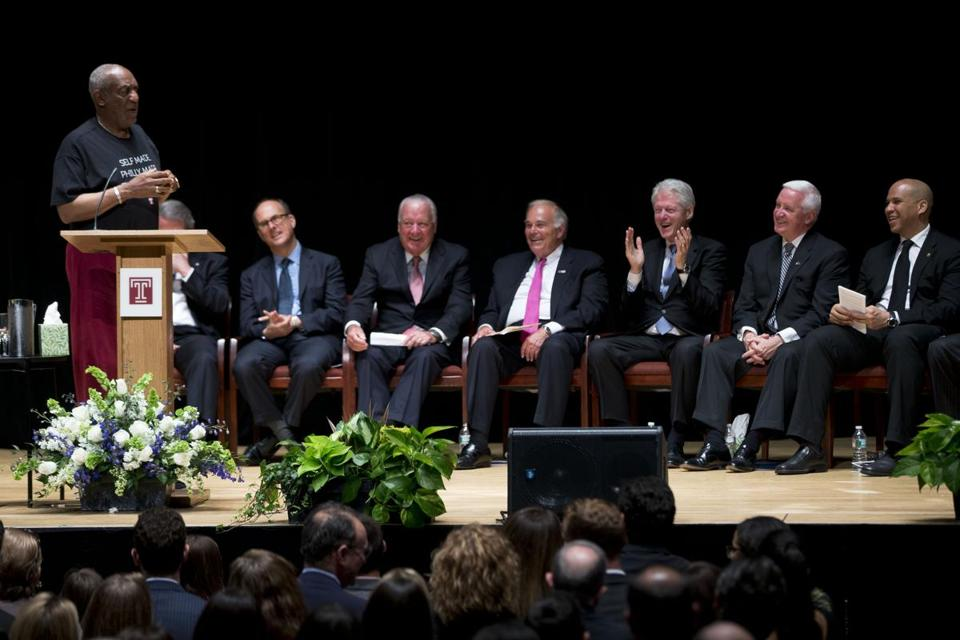 Bill Cosby spoke at the memorial service for Lewis Katz as USSenator Cory Booker, Pennsylvania Governor Tom Corbett, former President Bill Clinton, former Pennsylvania Governor Ed Rendell, Temple University Board of Trustees chairman Patrick O'Connor, and Rabbi Aaron Krupnick loked on.