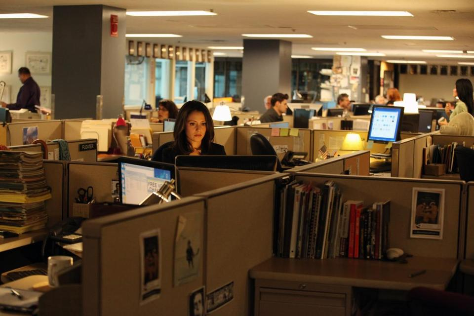 "Italia Ricci (pictured in the Globe newsroom) stars as a reporter for the fictional Boston Post, who finds out she has cancer in the ABC Family dramedy ""Chasing Life."""