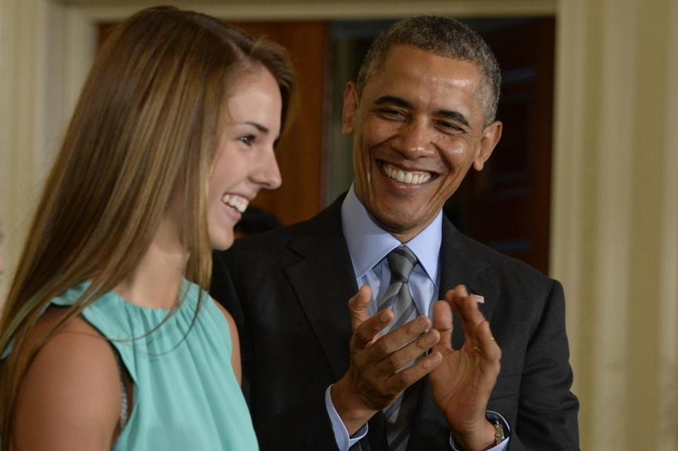 President Obama applauded Victoria Bellucci, a 2014 high school graduate who has had five concussions, at the summit.