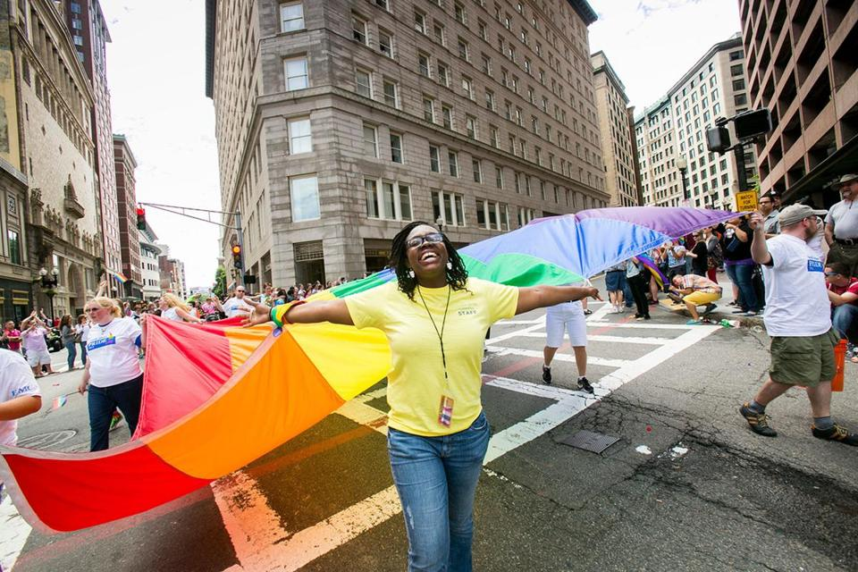 A group marches through Boston during the annual 2014 Pride Parade.