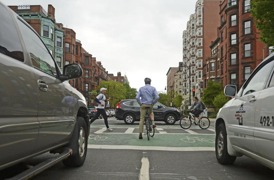 A bicyclist waited to cross Massachusetts Avenue in Boston.