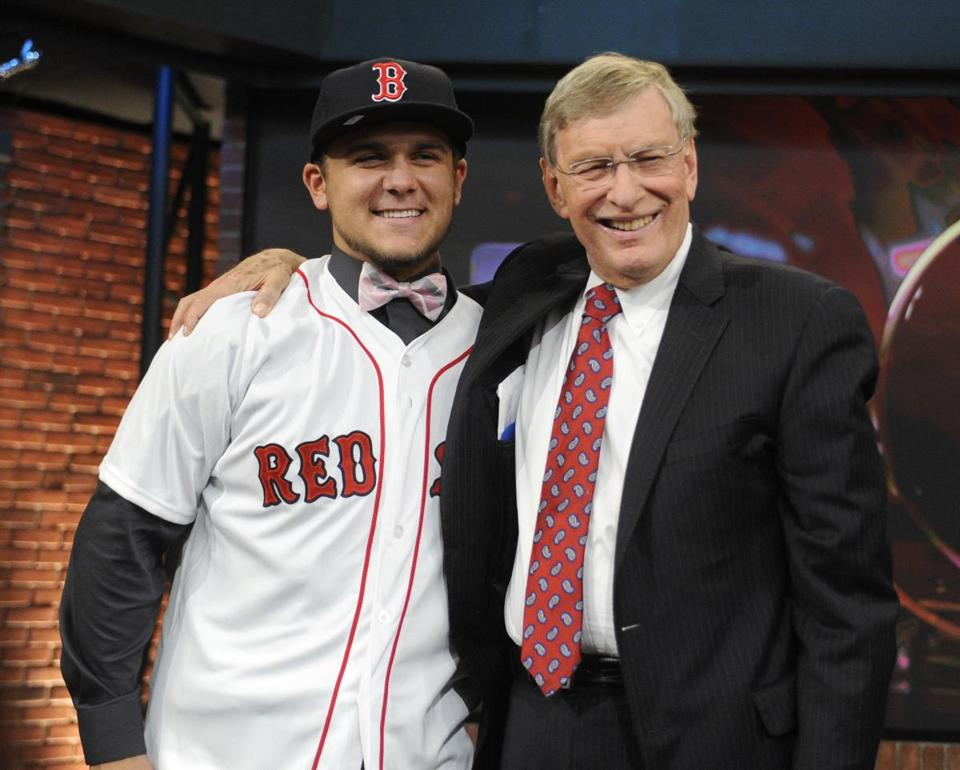 Commissioner Bud Selig, right, poses with shortstop Michael Chavis at the 2014 MLB baseball draft Thursday. Chavis was selected by the Red Sox with the 26th pick in the first round.